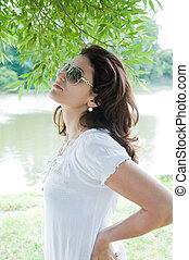 Beautiful girl in the park in summer