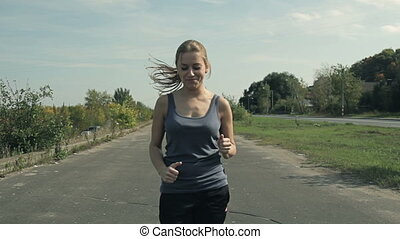 beautiful girl in the sport jogging
