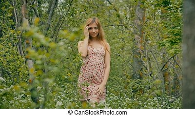 beautiful girl in the spring forest - beautiful blonde girl...