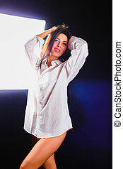 Beautiful girl in the studio on a black background
