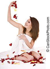 Beautiful girl in towel with  rose petal.