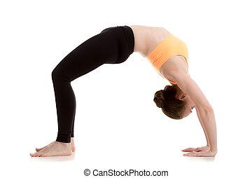 Beautiful girl in urdhva dhanurasana yoga Pose - Beautiful...