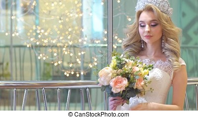 Beautiful Girl in Wedding Dress Poses for the Photographer