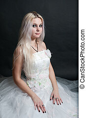 Beautiful girl in white dress on black background