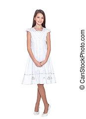 Beautiful girl in white dress posing on white background