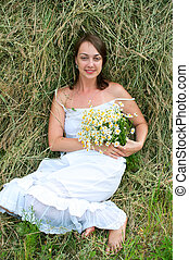 girl in white dress with chamomiles