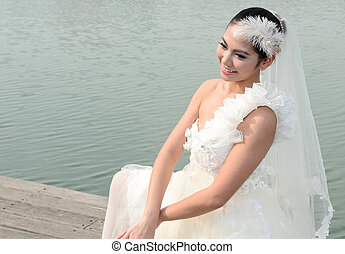 Beautiful girl in white gown of the bride