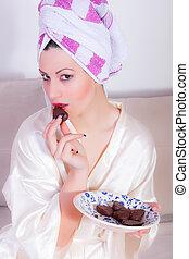 Beautiful girl is eating chocolate