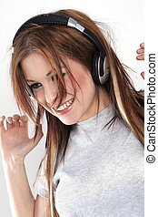 Beautiful girl is listen to the music