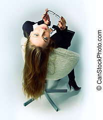beautiful girl is sitting in a chair
