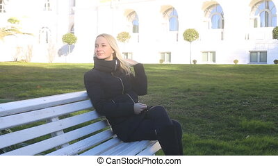 Beautiful Girl is sitting on the bench