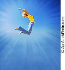 Beautiful girl jumps in the sky