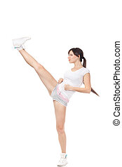 Beautiful girl kicking with the leg isolated on white background
