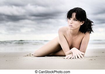 Beautiful girl laying on beach