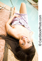 Beautiful Girl Laying On Side Of Pool