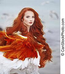 beautiful girl like a swan on the beach
