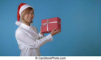 beautiful girl like santa holding gift