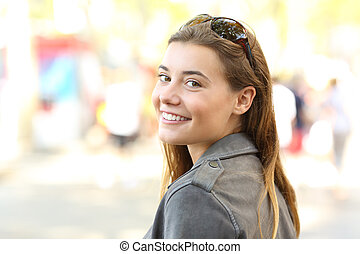 Beautiful girl looking at camera on the street