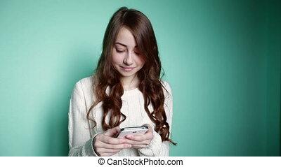 Beautiful girl looking in the phone