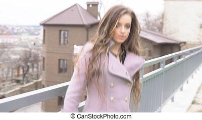 beautiful girl looks at city walk
