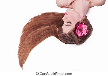 beautiful girl lying among rose petals. isolated