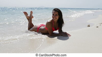 Beautiful Girl Lying In Water On Beach In Bikini Happy...