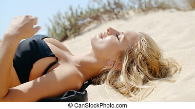 Beautiful Girl Lying on Sandy Dune