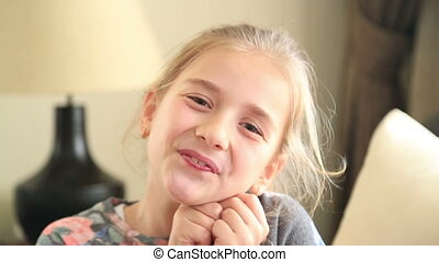 Beautiful girl making funny faces - Happy school girl making...