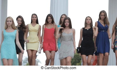 Beautiful girl model walking on the street