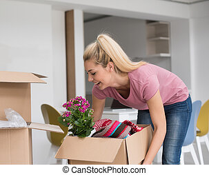 girl moving in the new apartment