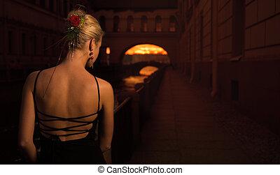 Beautiful girl near in old city near the river