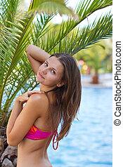 beautiful girl near the palm trees
