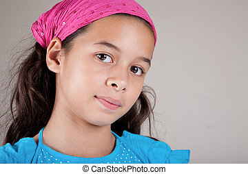 Beautiful girl of European and Asian parentage with pink bandanna.