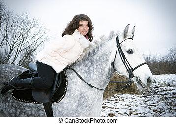 Girl on a horse. winter landscape