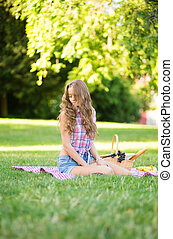 Beautiful girl on a picnic in park