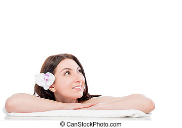 beautiful girl on a spa procedure looking at the empty space