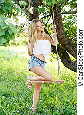 Beautiful girl on a swing - Summer, warm. Cute, young girl ...
