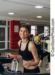 Beautiful girl on a treadmill