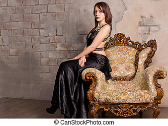 Beautiful girl on a vintage armchair