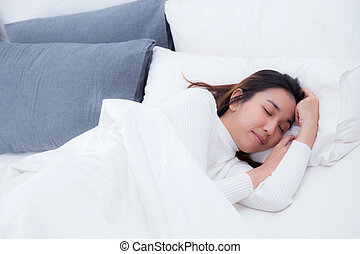 Beautiful girl on bed sleeping at home in the bedroom.