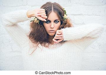 Beautiful girl on brick wall background