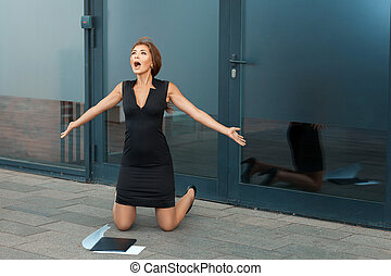 Beautiful girl on her knees and screaming for joy.