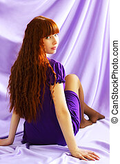 Beautiful girl on purple background