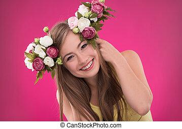 Beautiful girl on rose background