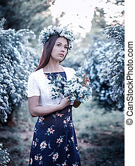 beautiful girl on the background of a flowering tree