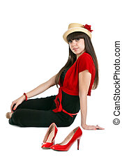 Beautiful girl on the background of a pair of red women's shoes.