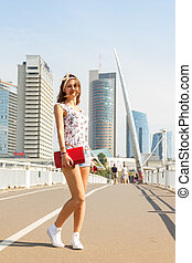 beautiful girl on the background of city