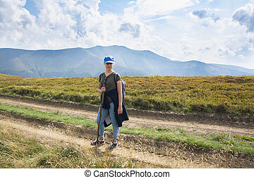 Beautiful girl on the background of the Carpathian mountains in summer.
