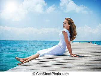 Beautiful Girl on The Pier. Ocean