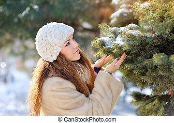 beautiful girl on the street in winter